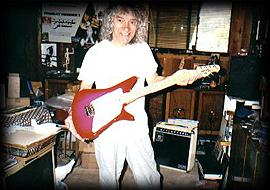 Albert Lee with Music Man guitar in home studio
